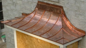 copper standing seam roofing on a bay window